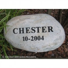 A simple memorial for Chester, engraved on river rock.